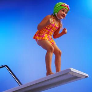 ca. 2001 --- Girl Preparing to Pool Dive --- Image by © Royalty-Free/Corbis